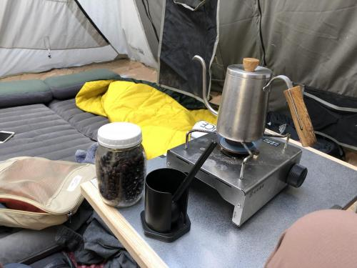 Preparing coffee inside our tent because its too cold outside